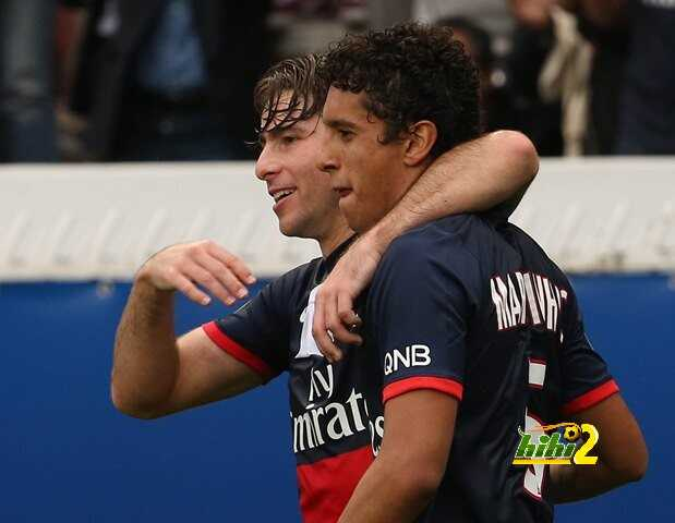 Paris Saint-Germain's Brazilian defender Marquinhos (R) celebrates with his teammate Maxwell after scoring a goal during the French L1 football match between Paris Saint-Germain and Toulouse at the Parc des Princes Stadium in Paris on September 28, 2013.  AFP PHOTO / FRANCK FIFE