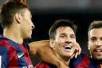 Barcelona's Lionel Messi (C) celebrates his second goal with teammate Munir El Haddadi (L) and Jordi Alba during their Spanish first division soccer match against Elche at Nou Camp stadium in Barcelona, August 24, 2014.  REUTERS/Gustau Nacarino(SPAIN - Tags: SPORT SOCCER)