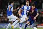 BARCELONA, SPAIN - MAY 05:  Lionel Messi of FC Barcelona duels for the ball with Raul Baena of RCD Espanyol (L) and Joan Verdu of RCD Espanyol (C) during the La Liga match between FC Barcelona and RCD Espanyol at Camp Nou on May 5, 2012 in Barcelona, Spain.  (Photo by David Ramos/Getty Images)