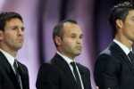 """Argentinian football player Lionel Messi (L), Spanish football player Andre Iniesta (C) and Portuguese football player Cristiano Ronaldo wait for the announcement of the """"UEFA Best Player in Europe 2012 Award"""", on August 30, 2012 in Monaco before the Champions League group stage draw. AFP PHOTO / VALERY HACHE"""