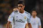 BARCELONA, SPAIN - OCTOBER 26:  Raphael Varane of Real Madrid CF in action during the La Liga match between FC Barcelona and Real Madrid CF at Camp Nou stadium on October 26, 2013 in Barcelona, Spain.  (Photo by Denis Doyle/Getty Images)