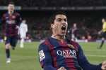 """Barcelona's Uruguayan forward Luis Suarez (R) celebrates his goal during the """"clasico"""" Spanish league football match FC Barcelona vs Real Madrid CF at the Camp Nou stadium in Barcelona on March 22, 2015.  AFP PHOTO / JOSEP LAGO        (Photo credit should read JOSEP LAGO/AFP/Getty Images)"""