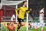 STUTTGART, GERMANY - FEBRUARY 09:  Marco Reus of Borussia Dortmund celebrates as he scores their first goal during the DFB Cup Quarter Final match between VfB Stuttgart and Borussia Dortmund at Mercedes-Benz Arena on February 9, 2016 in Stuttgart, Germany.  (Photo by Matthias Hangst/Bongarts/Getty Images)