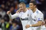 Real Madrid's Karim Benzema (L) celebrates his goal with teammate Cristiano Ronaldo during their Spanish King's Cup soccer match at Santiago Bernabeu stadium in Madrid December 22, 2010. REUTERS/ Felix Ordonez(SPAIN - Tags: SPORT SOCCER)