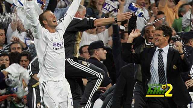 Madrid, SPAIN: Real Madrid's David Beckham (L) and Italian coach Fabio Capello celebrate with teammates after Real won the Spanish league title by beating Mallorca in the final Spanish league football match of the season, 17 June 2007 at the Santiago Bernabeu stadium in Madrid. Real won 3-1 to win their 30th league title. AFP PHOTO/ Bru GARCIA (Photo credit should read BRU GARCIA/AFP/Getty Images)